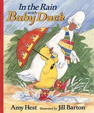 En la lluvia con pato bebé